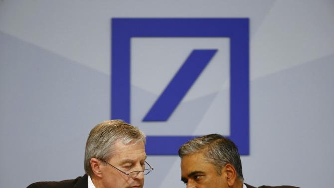 Jain and Fitschen, co-CEOs of Deutsche Bank, speak at a news conference in Frankfurt