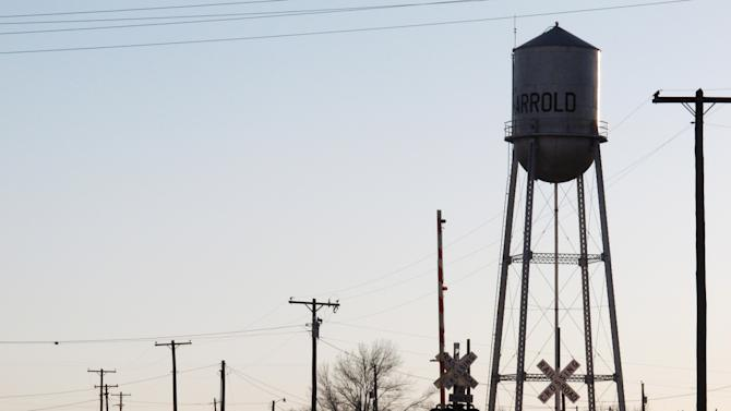In Monday, Dec. 17, 2012 photo, the town's water tower rises above the railroad tracks in Harrold, Texas. The rural town's lone school has a policy allowing teachers and other employees to carry concealed weapons on campus. Some lawmakers in at least five other states are looking into similar legislation in the wake of last week's deadly elementary school shooting in Newton, Conn. Anti-gun groups oppose the measure. (AP Photo/Angela K. Brown)