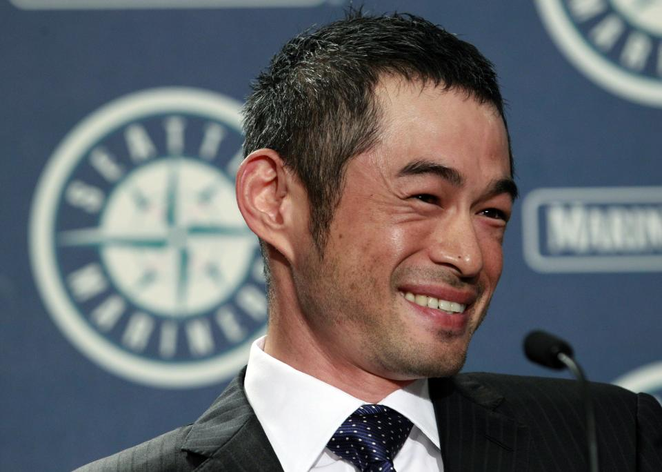 New York Yankees' Ichiro Suzuki smiles during a news conference, Monday, July 23, 2012, in Seattle. The Seattle Mariners announced that Suzuki, who has played with the Mariners since 2001, was traded to the Yankees. (AP Photo/Elaine Thompson)