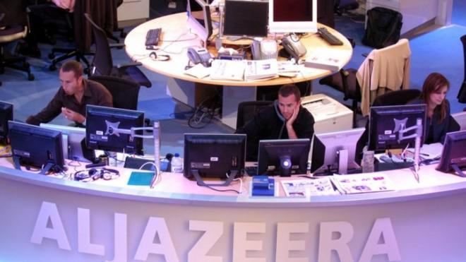 Al Jazeera English Channel staff prepare for a broadcast in the Doha news room in Qatar in 2006.