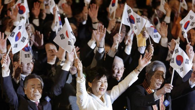 South Korean President Park Geun-hye (front C) cheers with a national flag while celebrating the 96th anniversary of Independence Movement Day, which commemorates the country's declaration of independence from Japanese colonization, in Seoul