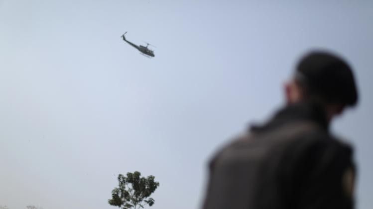 A helicopter patrols as security forces are deployed in Escuintla