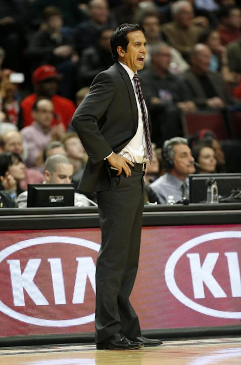 Miami Heat head coach Erik Spoelstra directs his team against the Chicago Bulls during the second half of an NBA basketball game in Chicago, Thursday, Dec. 5, 2013. The Bulls defeated the Heat 107-87