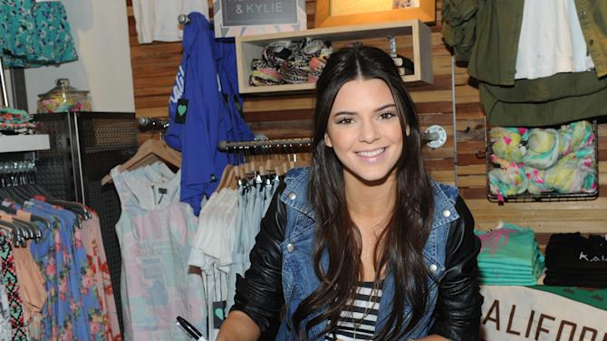 Kendall Jenner signs autographs during a public appearance to launch the Kendall & Kylie collection exclusively at PacSun, Friday, February 8, 2013, on Long Island, New York.   (Photo by Diane Bondareff/Invision for PacSun/AP Images)