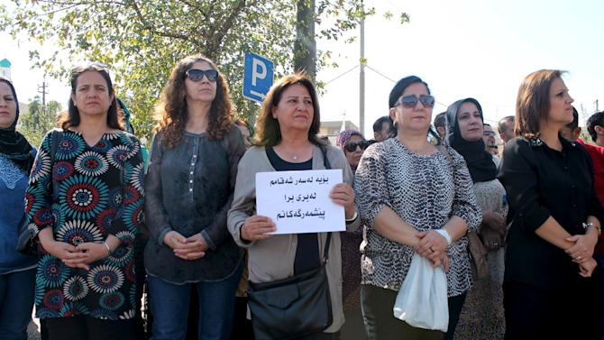 Kurdish residents take part in a protest in Sulaimaniya