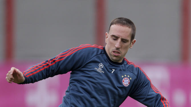 FILE - In this April 8, 2014, file photo Bayern's Franck Ribery of France stops a ball during a training session in Munich, southern Germany. Ribery will miss Bayern Munich's opening Champions League game against Manchester City on Wednesday, Sept. 17, 2014, because of a recurrence of his knee problem. (AP Photo/Matthias Schrader, File)