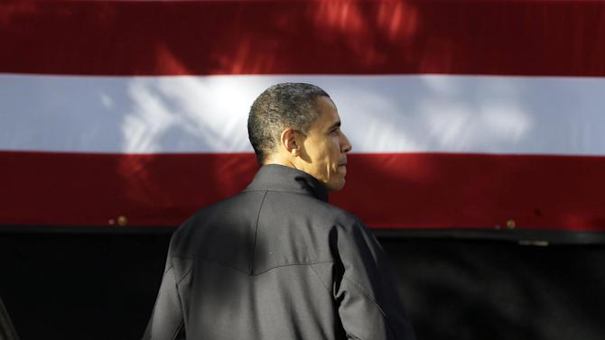 President Barack Obama looks over to a group of supporters after walking off stage at a campaign event at the University of Wisconsin-Madison, Thursday, Oct. 4, 2012, in Madison, Wis. (AP Photo/Pablo Martinez Monsivais)