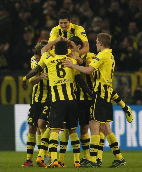 Borussia Dortmund's players celebrate a goal against Shakhtar Donetsk during their Champions League soccer match in Dortmund