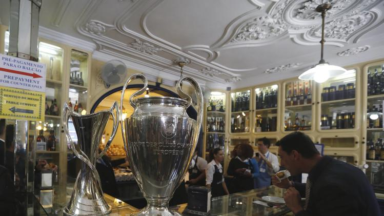The Champions League trophy is displayed at Pasteis de Belem cafe during its parade around the city in Lisbon