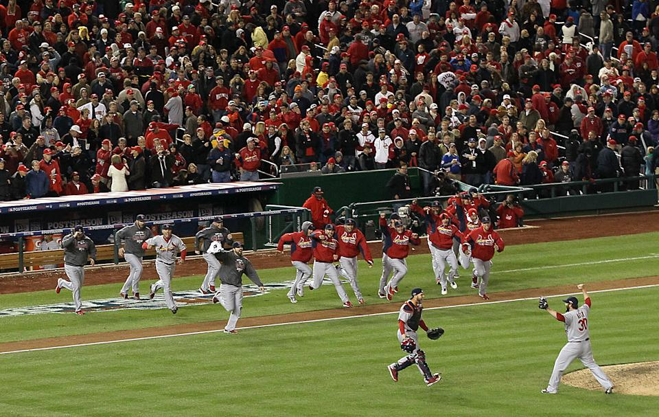 Cardinals players including catcher Tony Cruz and closer Jason Motte (30) celebrate the final out during Game 5 of the National League Division Series between the St. Louis Cardinals and the Washington Nationals on Friday, Oct. 12, 2012, at Nationals Park in Washington, D.C. (AP Photo/Chris Lee, Post Dispatch)