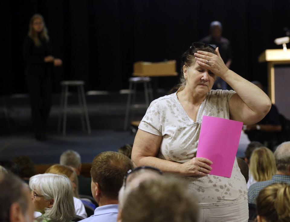 Judy Scott, of Black Forest, Colo. waits for an informational meeting for residents affected by the Black Forest Fire at Palmer Ridge High School in Monument, Colo. on Saturday, June 15, 2013. Scott's home was partially damaged by the fire. (AP Photo/Marcio Jose Sanchez)