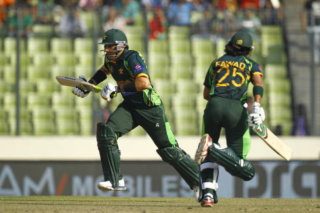 Pakistan's cricket captain Misbah-ul-Haq, left, and Fawad Alam run between the wickets during their Asia Cup final cricket match in Dhaka, Bangladesh, Saturday, March 8, 2014. (AP Photo/A.M. Ahad)