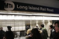Patrons are directed away from the Long Island Railroad which is being closed off at Penn Station as service is suspended Wednesday, Nov. 7, 2012, in New York. One of the nation's largest commuter railroads is suspending service because of a nor'easter sweeping the same regions hit by Superstorm Sandy more than a week ago. (AP Photo/Frank Franklin II)