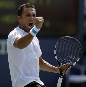 Victor Estrella Burgos, of Dominican Republic, reacts against Igor Sijsling, of the Netherlands, during the first round of the 2014 U.S. Open tennis tournament, Tuesday, Aug. 26, 2014, in New York. (AP Photo/Darron Cummings)