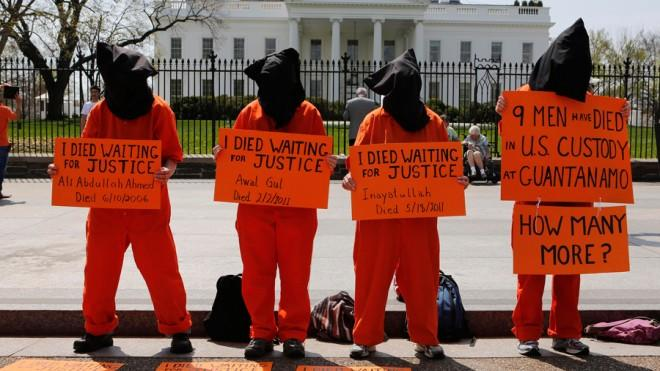 Activists gather in front of the White House on April 11 to demand the closing of Guantanamo Bay.