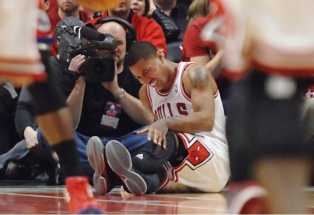 Chicago Bulls point guard Derrick Rose reats after injuring his leg in the fourth quarter of Game 1 in the first round of the NBA basketball playoffs against the Philadelphia 76ers Saturday, April 28,