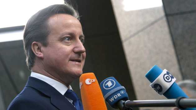 British Prime Minister David Cameron speaks with journalists as he arrives for an EU summit at the EU Council building in Brussels on Thursday, Nov. 22, 2012. EU leaders begin what is expected to be a marathon summit on the budget for the years 2014-2020. The meeting could last through Saturday and break up with no result and lots of finger-pointing. (AP Photo/Virginia Mayo)