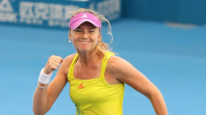 Daniela Hantuchova of Slovakia reacts after beating Sara Errani of Italy 4-6, 6-1, 7-5 during their match at the Brisbane International tennis tournament in Brisbane, Australia, Tuesday, Jan. 1, 2013. (AP Photo/Tertius Pickard)