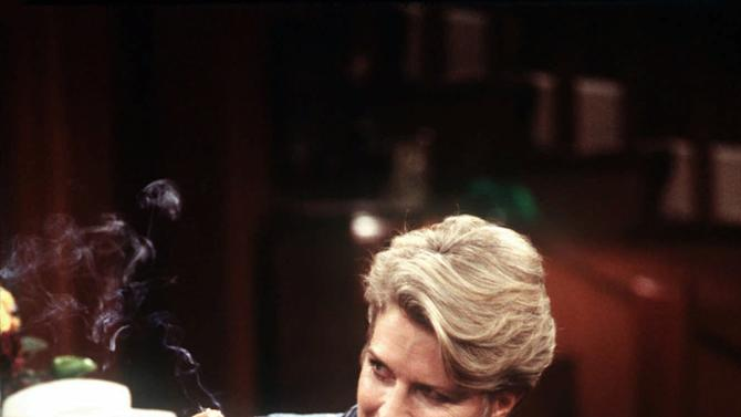 """FILE - In this 1997 file photo provided by CBS, Murphy Brown, portrayed by actress Candice Bergen, smokes a marijuana cigarette to quell nausea induced by the chemotherapy used to treat her breast cancer. On the occasion of  """"Legalization Day,"""" Thursday, Dec. 6, 2012, when Washington's new law takes effect, AP takes a look back at the cultural and legal status of the """"evil weed"""" in American history. (AP Photo/CBS, Spike Nannarello, File)"""