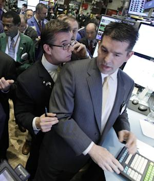 Steven Capo, left, consults with specialist David Haubner, right, during the IPO of Proto Labs on the floor of the New York Stock Exchange Friday, Feb. 24, 2012. The Dow Jones industrial average is pushing closer to 13,000 at the opening of trading, and other stock indexes are opening higher ahead of reports on new home sales and consumer sentiment. (AP Photo/Richard Drew)