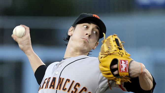 File - In this Sept. 14, 2013 file photo, San Francisco Giants starter Tim Lincecum pitches to the Los Angeles Dodgers in the first inning of a baseball game in Los Angeles. Lincecum is staying put with the Giants just as he hoped, reaching agreement Tuesday, OCt. 22, 2013, on a $35 million, two-year contract through the 2015 season. The deal is pending a physical, which hadn't been set. (AP Photo/Reed Saxon, File)