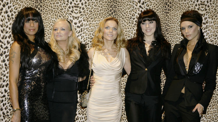 FILE- In this Jan. 14, 2008 file photo, the Spice Girls, from left, Melanie Brown, Emma Bunton, Geri Halliwell  Melanie Chishlom and Victoria Beckham pose backstage prior to the start of the Roberto Cavalli Fall/Winter 2008/2009 men's collection fashion show, in Milan, Italy, (AP Photo/Luca Bruno, File)