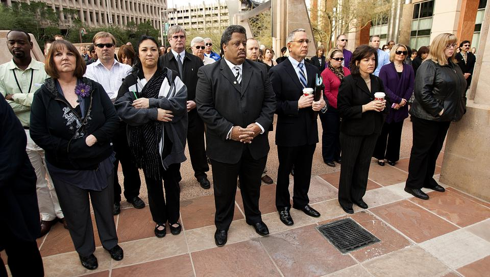 Phoenix city employees observe a moment of silence in front of City Hall , Monday, Jan. 10, 2011, in honor of those shot in Tucson, including Rep. Gabrielle Giffords. (AP Photo/The Arizona Republic, Tom Tingle)  MARICOPA COUNTY OUT, MAGS OUT.