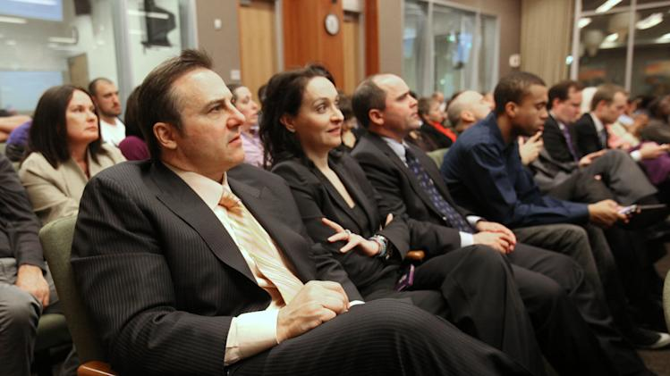 Gavin Maloof, left, co-owner of the Sacramento Kings, listens as a new sports and entertainment arena plan is discussed during a Sacramento City Council meeting where a vote was scheduled to be taken on a new sports arena proposal, in Sacramento, Calif. Tuesday, March 6, 2012. (AP Photo/Rich Pedroncelli)