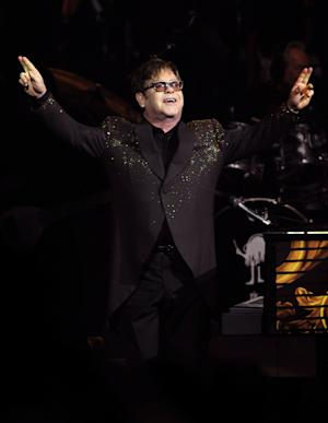 """In this photo provided by the Las Vegas News Bureau, Elton John performs at The Colosseum at Caesars Palace on opening night of his new show, """"The Million Dollar Piano,"""" Wednesday, Sept. 28, 2011 in Las Vegas. Elton's appearance marks the beginning of a three-year residency at The Colosseum on the Las Vegas Strip. (AP Photo/Las Vegas News Bureau, Brian Jones)"""