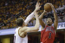 Chicago Bulls guard Derrick Rose (1) shoots against Cleveland Cavaliers center Timofey Mozgov during the first half of Game 1 in a second-round NBA basketball playoff series Monday, May 4, 2015, in Cleveland. (AP Photo/Tony Dejak)