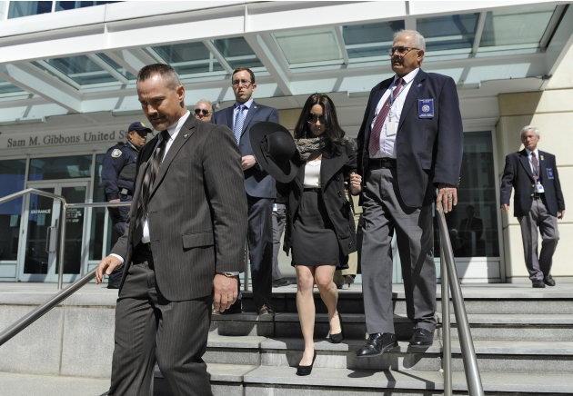 Casey Anthony, center, leaves the United States Courthouse in Tampa, Fla., with U.S. Marshals after a bankruptcy hearing Monday, March 4, 2013, in Tampa, Fla. Anthony has not made any public appearanc