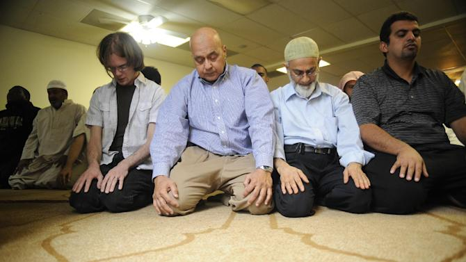 Muslims pray at the Islamic Center of Murfreesboro on the first day of the Islamic holy month of Ramadan Friday, July 20, 2012 in Murfreesboro, Tenn. A new mosque is nearing completion after a court battle with opposition groups. (AP Photo/Stephen Lance Dennee)