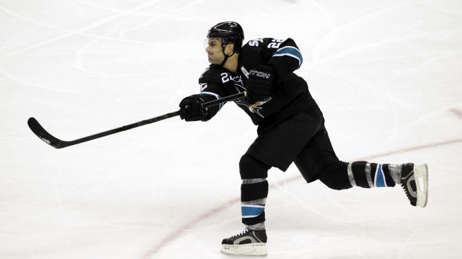In this Jan. 2, 2014 file photo, San Jose Sharks' Dan Boyle (22) shoots against the Edmonton Oilers during an NHL hockey game in San Jose, Calif. The New York Rangers have boosted their bid to make another postseason run. Defenseman Dan Boyle agreed to terms with the Rangers on Tuesday, July 1, 2014,  just after the start of NHL free agency