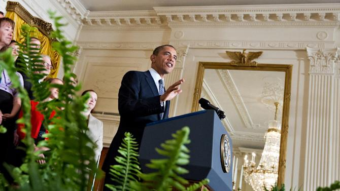 President Barack Obama lays out his plan to extend tax cuts for the middle class, during an announcement from the East Room of the White House in Washington, Monday, July 9, 2012.  (AP Photo/J. Scott Applewhite)
