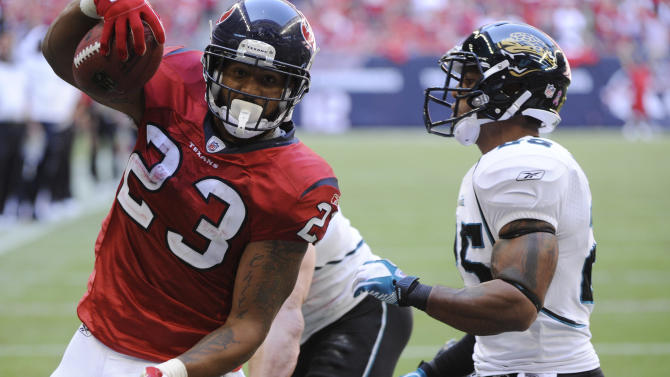 Houston Texans running back Arian Foster (23) carries the ball in for a touchdown in front of Jacksonville Jaguars strong safety Dwight Lowery (25) in the third quarter of an NFL football game Sunday, Oct. 30, 2011, in Houston. (AP Photo/Dave Einsel)