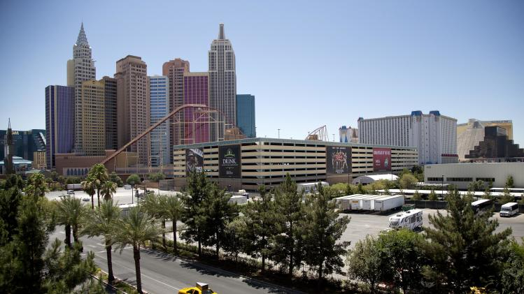 The New York-New York hotel-casino, left, is seen from the Monte Carlo parking garage west of The Strip Tuesday, June 18, 2013, in Las Vegas. Casino giant MGM Resorts International and entertainment company AEG announced Tuesday, June 18, 2013 that they've inked a deal to build a 20,000-seat Las Vegas Strip arena. Groundbreaking for the $350 million arena, in an area from Las Vegas Boulevard to Frank Sinatra Drive between the New York-New York and Monte Carlo resorts, is expected next summer, with completion by spring 2016. (AP Photo/Julie Jacobson)