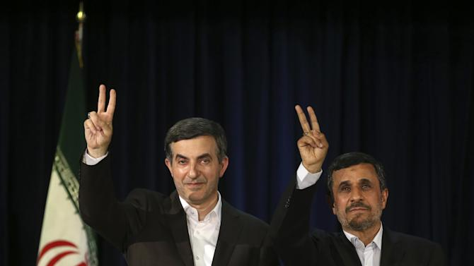 Iranian President Mahmoud Ahmadinejad, right, and his close ally Esfandiar Rahim Mashaei, flash victory signs at the start of their press conference, after registering candidacy of Rahim Mashaei for the upcoming presidential election, at the election headquarters of the interior ministry, in Tehran, Iran, Saturday, May 11, 2013. Iran's powerful former president Akbar Hashemi Rafsanjani has entered the race for the June presidential election. Simultaneously, President Mahmoud Ahmadinejad's close confident Esfandiar Rahim Mashaei also signed up in the last minutes before Saturday's registration deadline. (AP Photo/Ebrahim Noroozi)