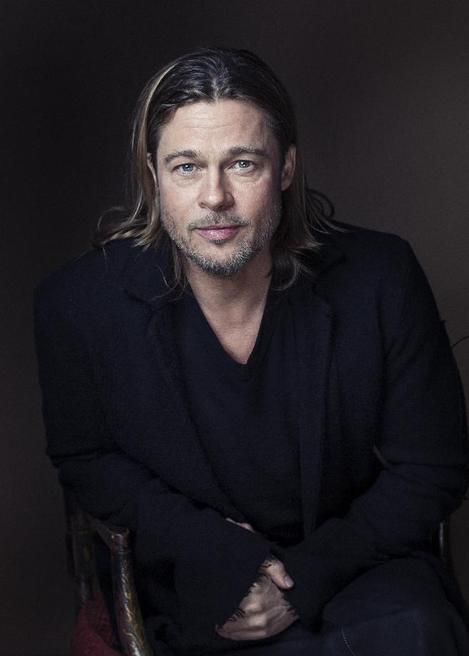 "Brad Pitt poses for a portrait to promote his film, ""Killing Them Softly,"" on Monday, Nov. 26, 2012 in New York. (Photo by Victoria Will/Invision/AP)"