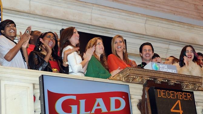 IMAGE DISTRIBUTED FOR GLAD - Ivanka Trump, center, mother and businesswoman, rings the New York Stock Exchange (NYSE) closing bell on behalf of The Glad Products Company in celebration of National Cookie Day and the 89th annual NYSE tree lighting, Tuesday, Dec. 4, 2012, in New York.  This holiday season, Glad will make a donation to its longstanding partner Cookies for Kids' Cancer, a nonprofit that raises funds for pediatric cancer research through cookie sales. (Photo by Diane Bondareff/Invision for Glad/AP Images)