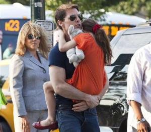 File photo of actor Tom Cruise carrying his daughter Suri into the Chelsea Piers sports facility in New York