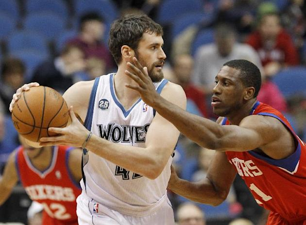 Minnesota Timberwolves forward Kevin Love, left,  looks to drive against Philadelphia 76ers forward Thaddeus Young, right, during the first quarter of an NBA basketball game in Minneapolis, Wednesday,