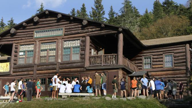 In this Sept. 14, 2011 photo, freshmen students line up for dinner during orientation at Dartmouth College's Moosilauke Ravine Lodge, in Warren, N.H. A University of New Hampshire professor who has done extensive research on outdoor orientation programs says that at a time when many colleges and universities are becoming more risk-averse, the number of outdoor orientation programs is growing. (AP Photo/Jim Cole)