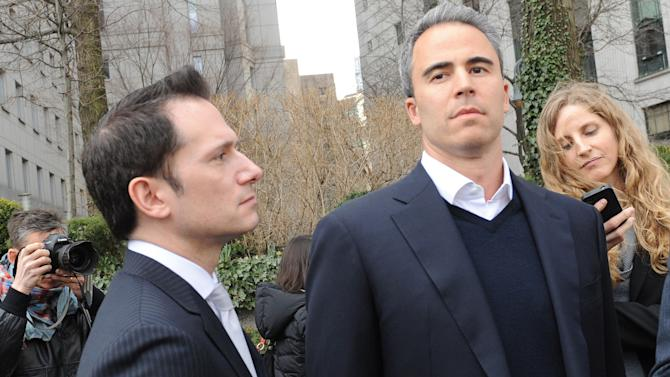 FILE - In this March 29, 2013 file photo, Michael Steinberg, second from right, exits Manhattan federal court with his defense attorney Barry Berke in New York. Lawyers have been given the green light to scan the social media sites of jurors. The American Bar Association says it's ethical for lawyers to scour online for publicly available musings of citizens called for jury service and even jurors in deliberations. Last year, New York defense attorney Berke hired a jury consultant firm and instructed it to search social media sites of potential jurors in the insider-trading case of Steinberg. The consultant was looking for anti-Wall Street comments or any other signs of possible bias. Prospective jurors thought to be biased were removed from the pool. (AP Photo/Louis Lanzano, File)