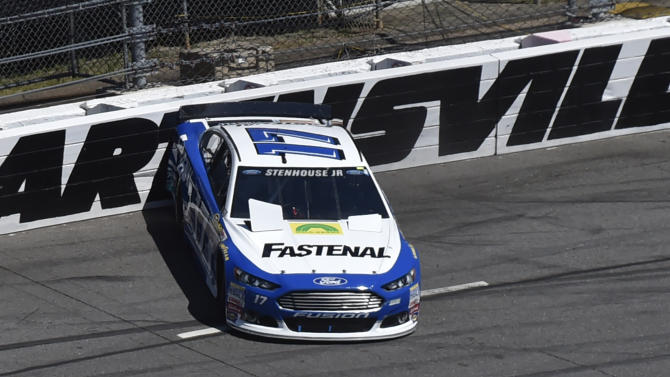 Ricky Stenhouse Jr., (17) scrubs the wall in turn four during the NASCAR Sprint Cup auto race at Martinsville Speedway in Martinsville, Va., Sunday, March 29, 2015. (AP Photo/Don Petersen)