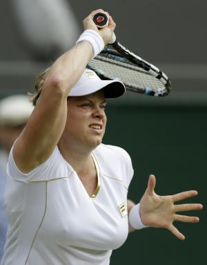 Kim Clijsters of Belgium returns a shot to Jelena Jankovic of Serbia during a first round women's singles match at the All England Lawn Tennis Championships at Wimbledon, England, Monday, June 25, 2012. (AP Photo/Tim Hales)