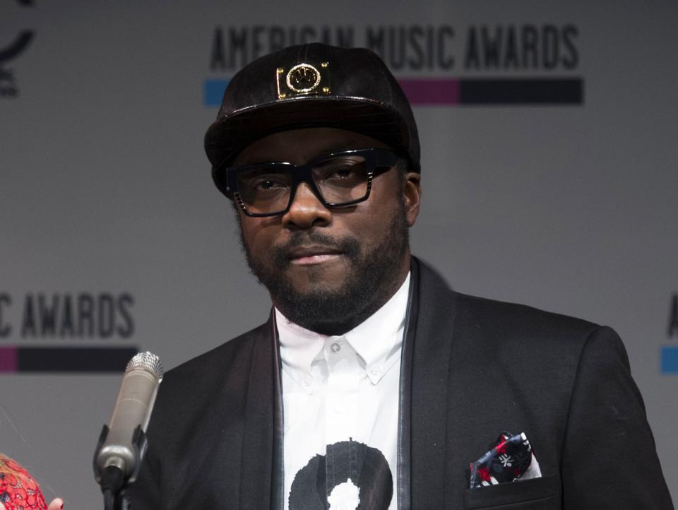 Will.i.am announces the nominees for the American Music Awards, on Thursday, Oct. 10, 2013 in New York. Will.i.am is executive producing the Britney Spears' eighth album. The untitled album does not have a release date.(Photo by Charles Sykes/Invision/AP)