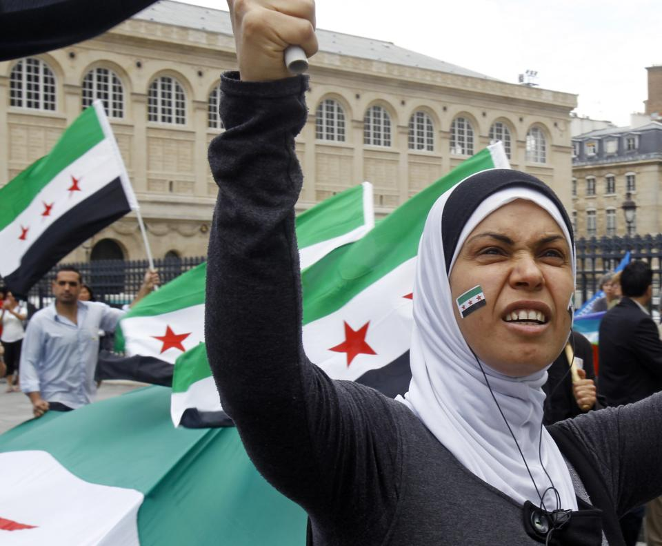 A March for the Syrian People gathers protesters in front of the Pantheon in Paris, Saturday, July 7, 2012. Demonstrators waving Syrian flags took to the streets to protest against Syrian regime of Bashar al Assad. (AP Photo/Remy de la Mauviniere)