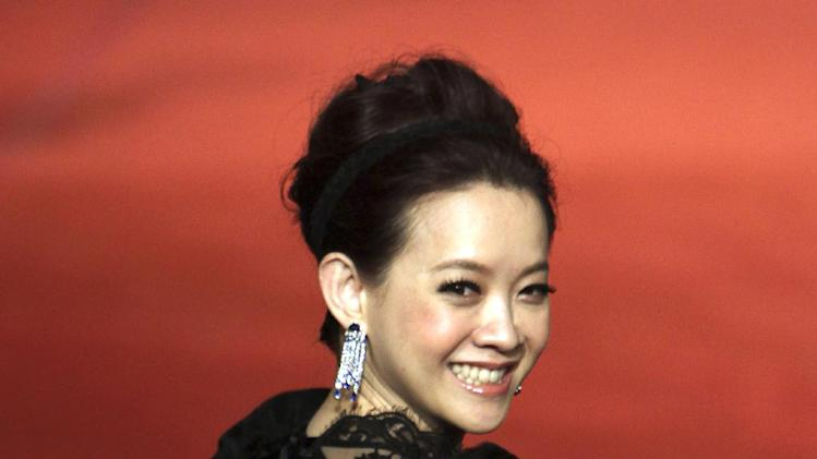 Hong Kong Actress BoWei Tsang smiles as she arrives at the 49th Golden Horse Awards at the Luodong Cultural Working House in Yilan County, Taiwan, Saturday, Nov. 24, 2012. Tsang is a host at this year's Golden Horse Awards -one of the Chinese-language film industry's biggest annual events.(AP Photo/Chiang Ying-ying)