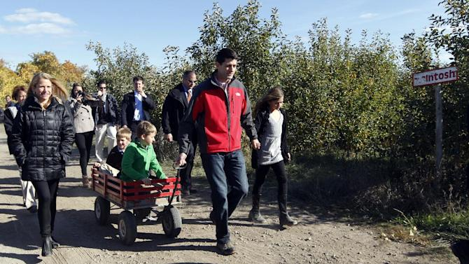 Janna Ryan, right, walks alongside her husband Republican vice presidential candidate, Rep. Paul Ryan, center, R-Wis., as he pulls his sons Charlie, front, and Sam in a wagon holding his daughter Liza's hand on their way to the pumpkin patch at the Apple Holler farm, Sunday, Oct. 7, 2012 in Sturtevant, Wis.  (AP Photo/Mary Altaffer)