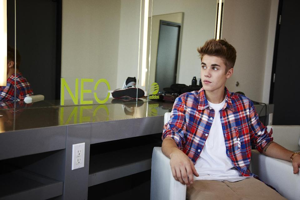 In this undated handout photo released by Adidas NEO Label, singer Justin Bieber poses for a portrait in Los Angeles. The teen superstar has teamed up with Adidas NEO Label as their new global style icon, in a two year partnership announced Tuesday, Oct. 16, 2012. (AP Photo/Adidas NEO Label)